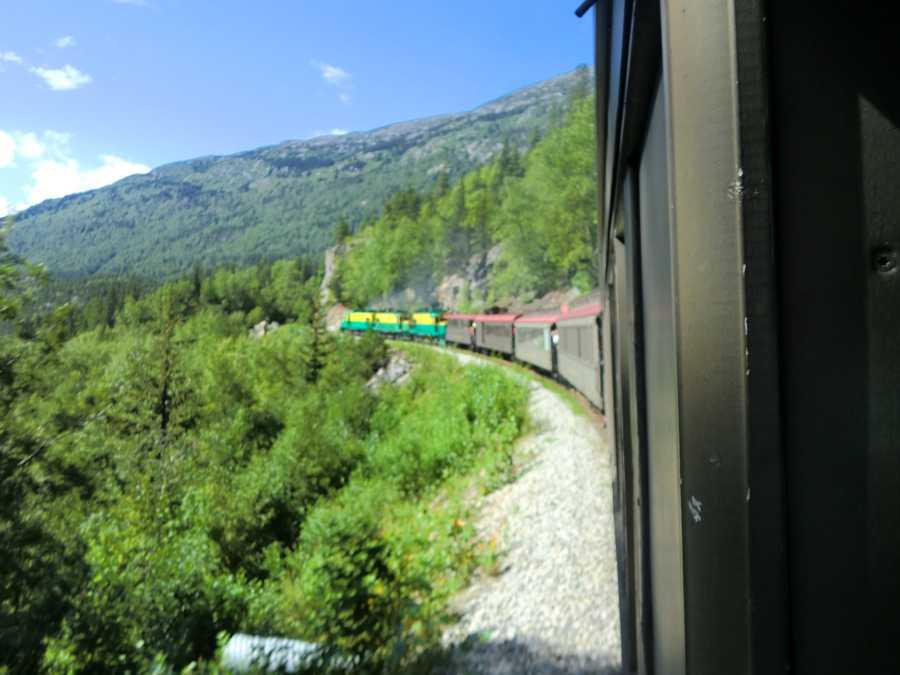 The White Pass Train takes the tour group on the scenic route through Alaska.