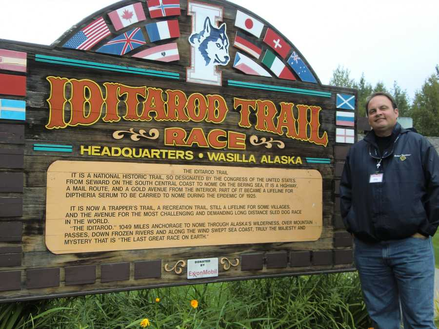 Austin stops for a minute in Wasilla, Alaska to get a pic with the IditarodTrail Sled Dog Racesign and to read about the history of the trail.