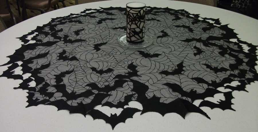 This table cloth accent with spider webbing and black bats make a great Halloween themed party and or wedding reception decoration. But remember if you use something like this then use it on all the tables. (Decorationsby Ted Nichols, Jr.)