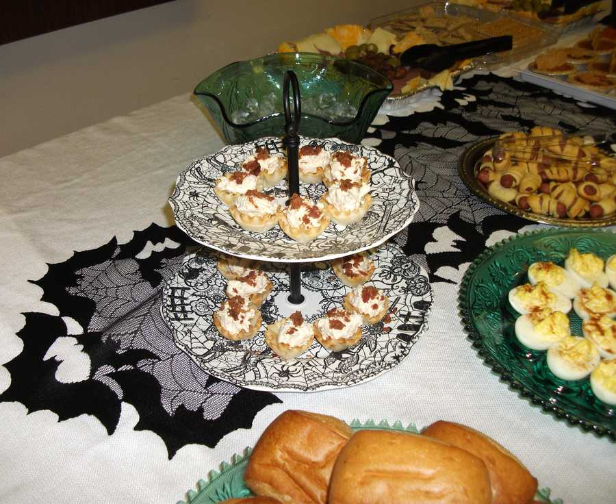 These Halloween decorations work well with a Halloween Themed Wedding. Servings of Hor d'oeuvres, deviled eggs and many other finger foods could help the wedding budget if the couples family and friends help out for the reception.(Food and Decorations by Ted Nichols, Jr.)