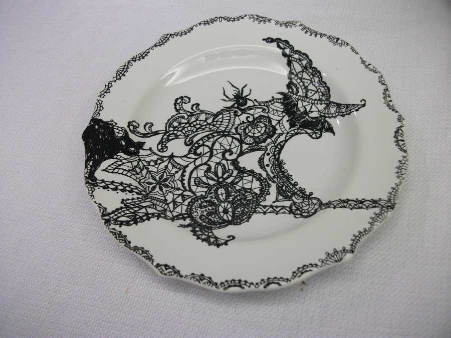 """Maybe mix the couples favorite movie with the Halloween Theme. Use these plates as """"Wizard of Oz Theme""""or think about Tim Burton's """"Corpse Bride"""" and get decorations that match that theme. (Decorations by Ted Nichols, Jr.)"""