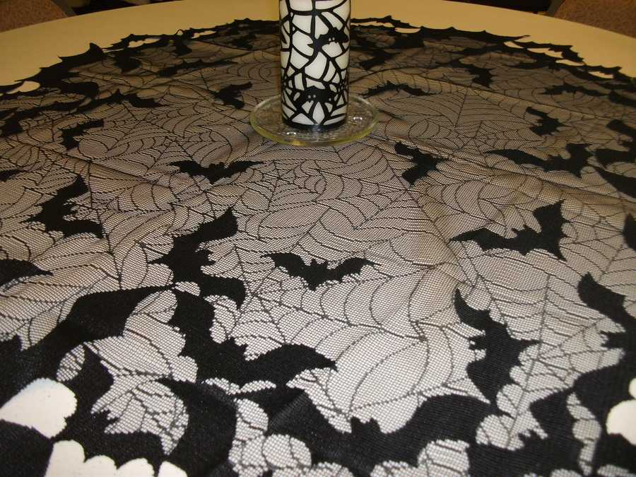 These incredible bats and spider webs make great table covers. Lace table clothes can be found at small lace stores or online.(Decorations by Ted Nichols, Jr.)