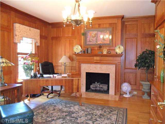 Cherry Paneled Study with marble fireplace