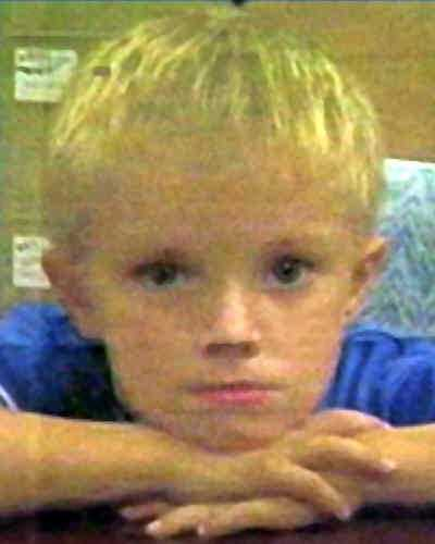 """Tristen was last seen walking near his home in Roseboro, NC on October 5, 2000. He may have been walking with a tan Chihuahua and a black Doberman. The dogs were subsequently located. At the time of his disappearance, Tristen was wearing a black T-shirt, blue jeans, and white tennis shoes. He has a scar on the left side of his neck. His full name is Tristen Alan Myers but he uses the nickname """"Buddy"""". He may be in need of medical attention."""