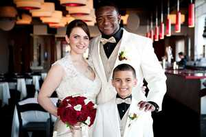 The couple looks great in their white with beautiful red roses used in the bouquet and boutonniere