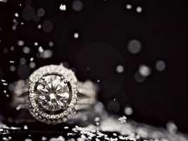 This diamond engagement ring with the snow falling around it was used in a New Year's Eve wedding ceremony. The photographers brought out the theme with the nice snow flakes falling.