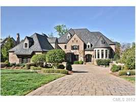 This four bedroom Waxhaw estate is priced at $2,600,000. The home features a wine cellar, home theater and palor.