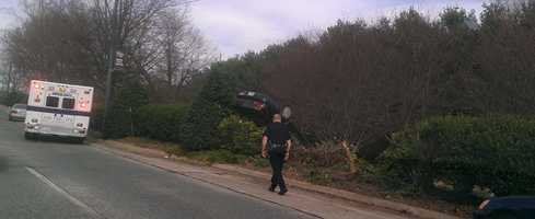University Parkway drivers saw this car crashed upside down onto bushes Tuesday morning. (John Norvell/WXII)