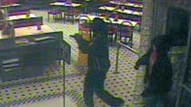 Surveillance image of robbery at Steak 'n Shake (Greensboro police)