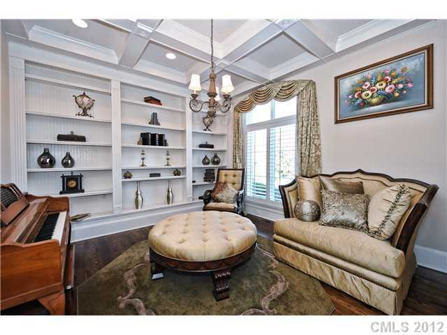 Living Room with built-in shelving and a coffered ceiling