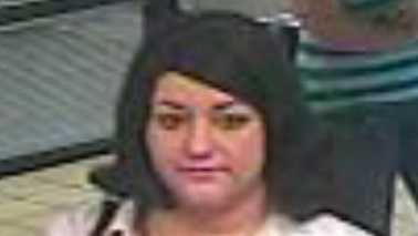 "This woman, seen from a surveillance camera, is wanted on suspicion of taking a ""large amount of money"" that an elderly woman had just withdrawn from a bank. (Winston-Salem police)"