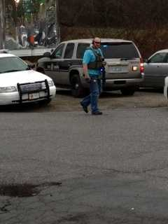 U.S. Marshals arrived at the scene of a standoff at a Jonesville hotel. (Nicole Ducouer/WXII)