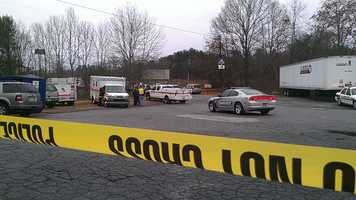 Police tape was extended farther from a Jonesville hotel, where a standoff took place. (William Bottomley/WXII)