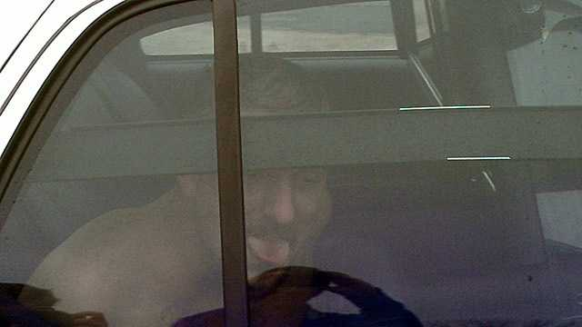 Photo of John Trenton Smith, standoff suspect, in custody (William Bottomley/WXII)