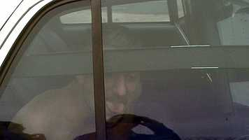 Photo of John Trenton Smith, standoff suspect, in custody (William Bottomley/WXII)