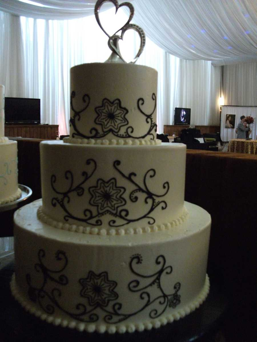 Wedding cakes can show your theme off which is Valentines and big hearts as cake toppers show your love.