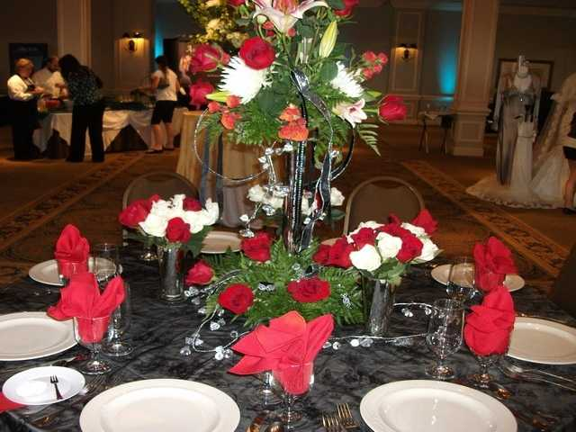 Red, pink and white are the colors of love and share your theme through flowers and the tablescapes.