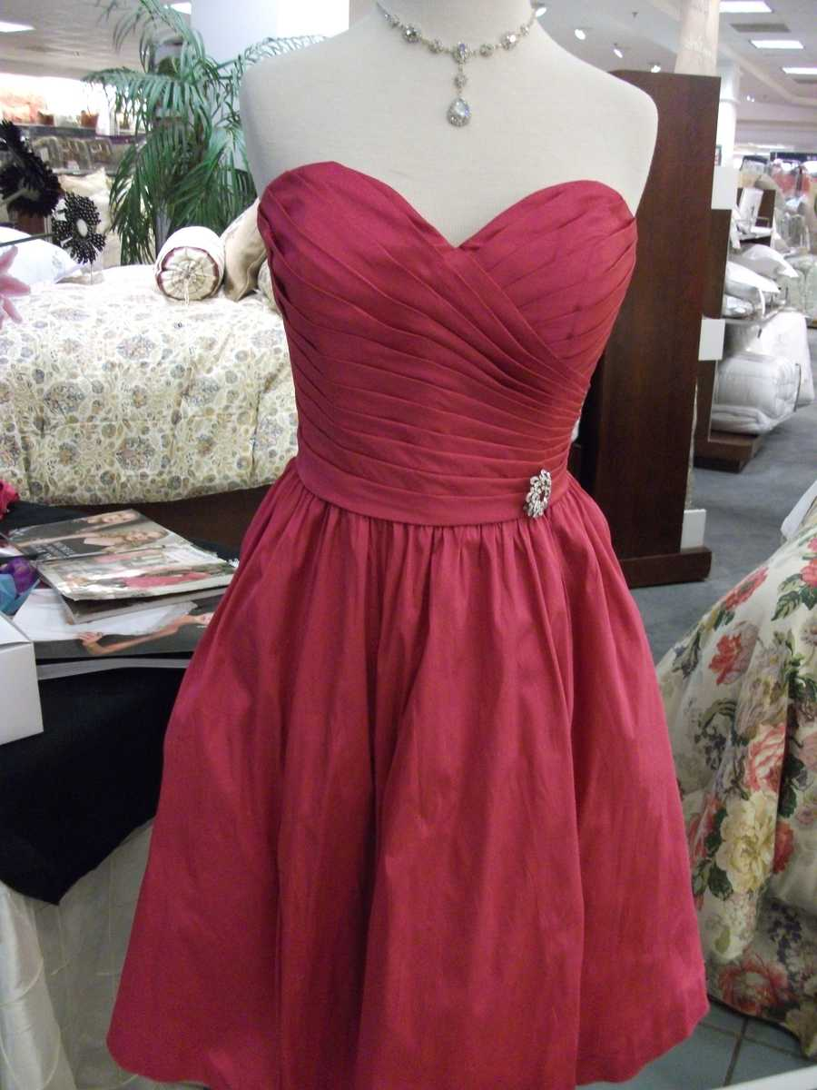Bridesmaids can wear red like this dress from Christophers while the bride wears white with hints of red or pink. Remember you can use other colors.