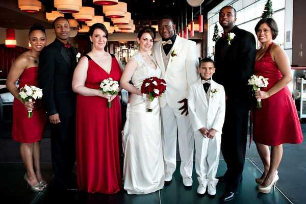 Beautiful reds, white and even black colors used in their wedding fashion make this whole wedding party look the part of a Valentine's Wedding Theme...