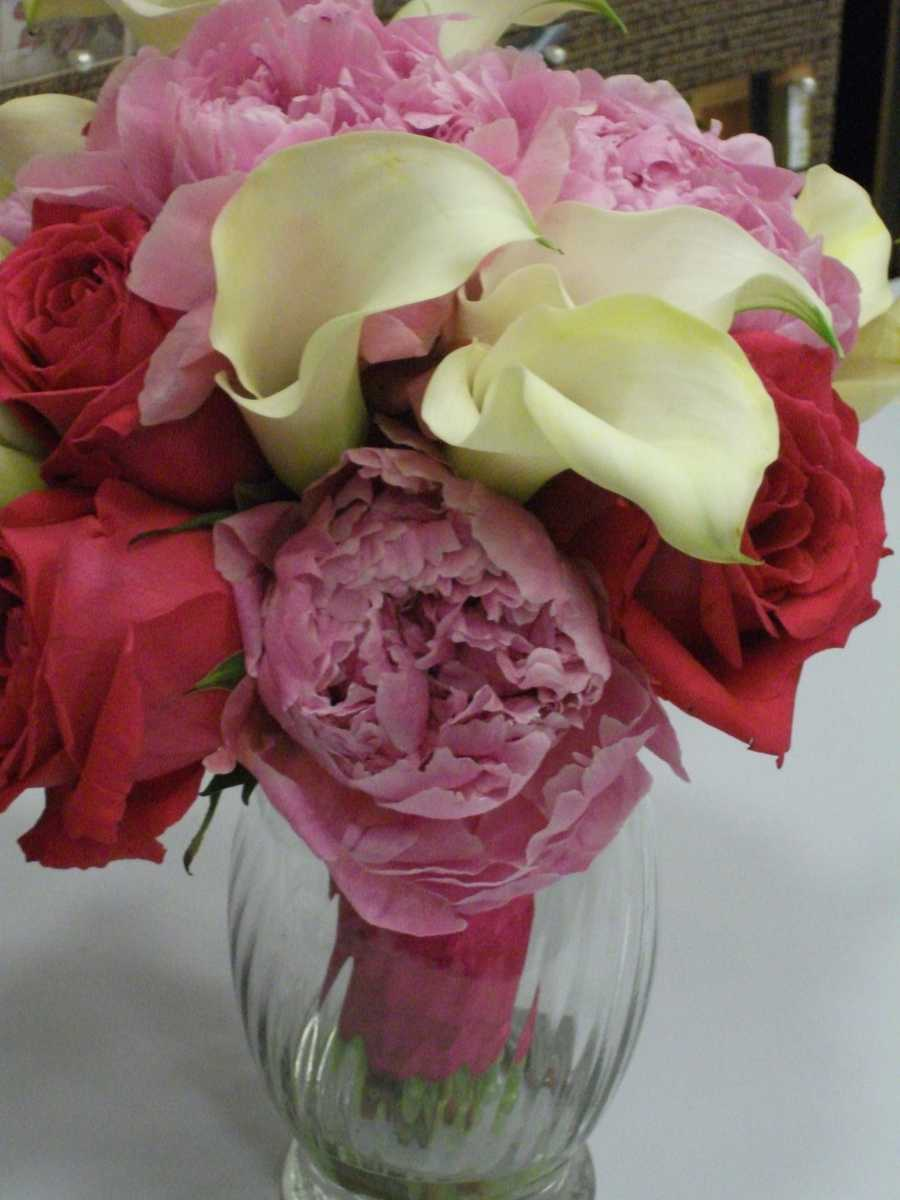 These beautiful pink, red and white flowers could be used in a bouquet or as decorations for the reception tables. But don't be scared to use other colors as well for a Valentine's Day Wedding Theme. (Beverly's of Midway Flowers and Gifts)
