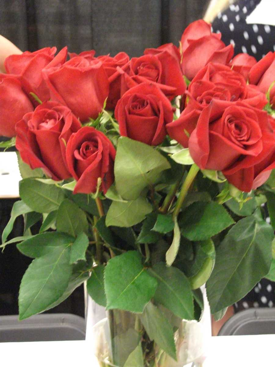 Just red roses send out love for this Valentine's Day Wedding Themed Wedding or think red for the bride bouquets and pink bouquets for the bridesmaids and reception tables.