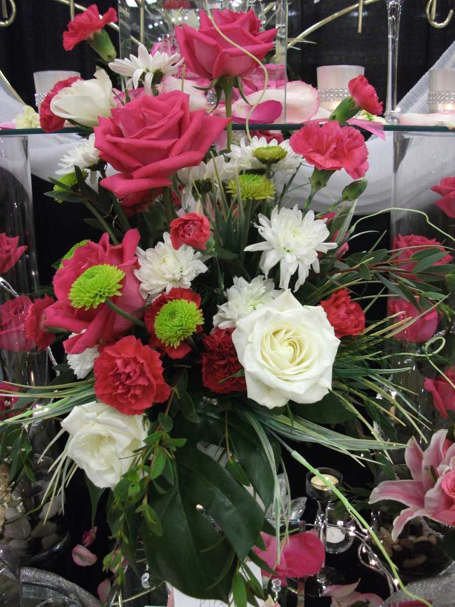 Notice these flowers have a hint of green along with the pink and whites. This added color makes the flowers pop for your theme. (Bennett's Baskets N Bows)