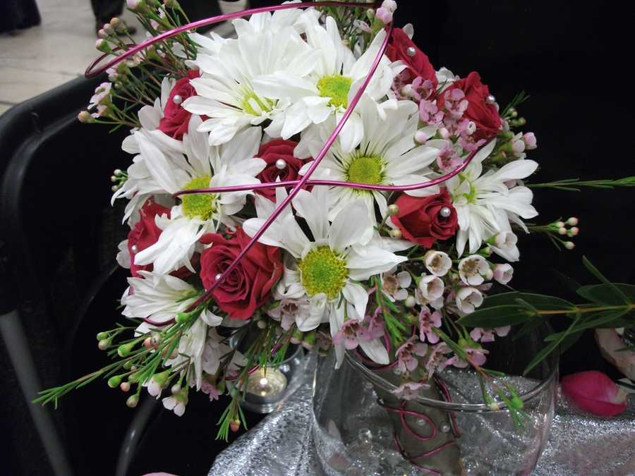 Another example of the lime green buttons in the daisy's give a pop of color to the regular red, pink and white colors for theValentine's Day Wedding Theme. (Bennett's Baskets N Bows)