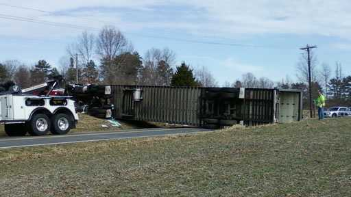 Tractor-trailer overturns on NC 62