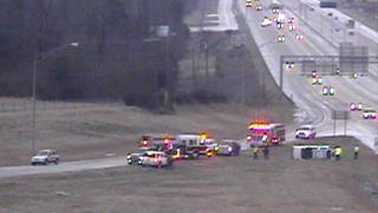 A vehicle overturned on an I-40 off-ramp to Sandy Ridge Road after sleet and freezing rain accumulated. (NCDOT traffic camera)
