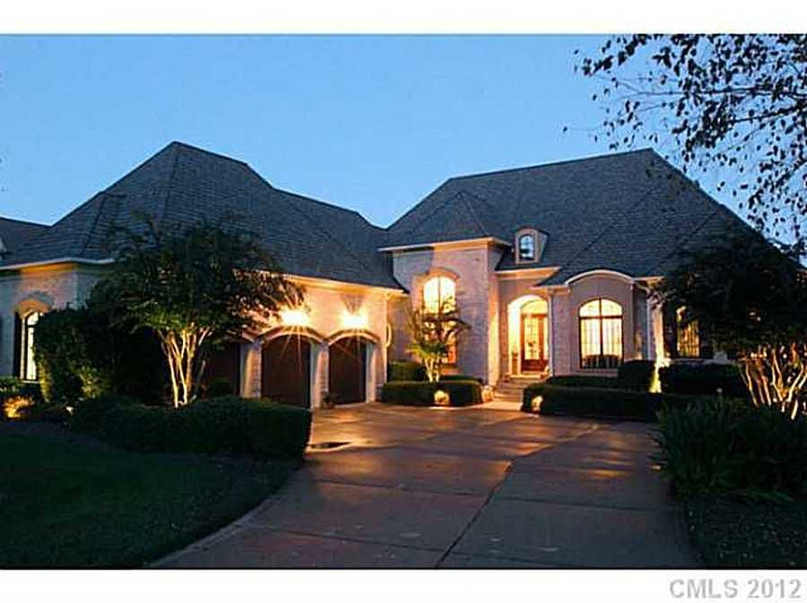 This Denver, North Carolina lakefront home is priced at $1,375,000. The home has four bedrooms and five bathrooms.