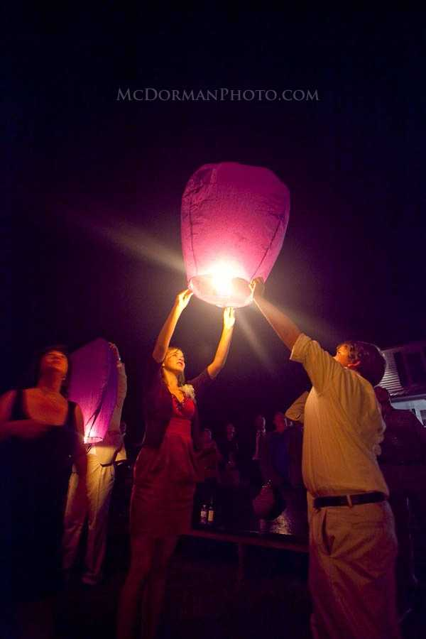 Doing something special like floating the lanterns at the end of the reception is a very romantic touch.