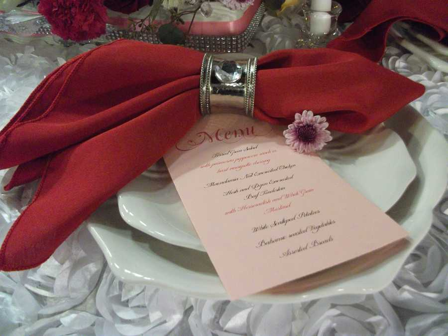 """These beautiful table settings can be used at your Valentine's Day dinner then have a note card with the menu on it and at the end have """"Will You Marry Me?"""" to ask for her hand in marriage. You could use the same decor for your wedding reception. With of course just the menu card. (E'MAGINE WEDDINGS AND EVENTS)"""