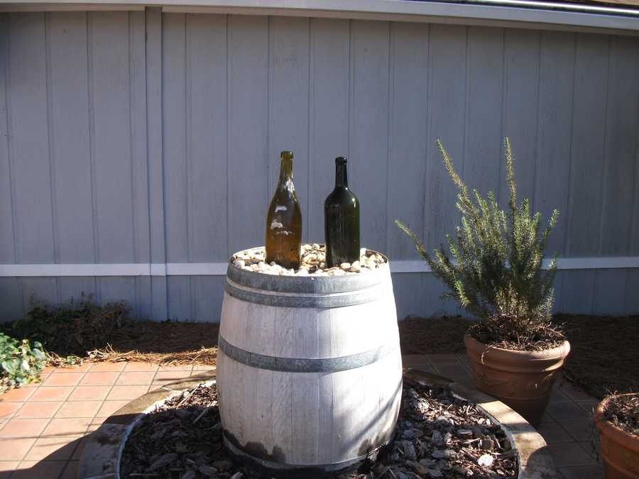 Several neat areas at the wineries to take photos for memories of your Bachelorette or Bachelor party group. These wine bottles and barrel is a water fountain with water pumping out of the bottles. (Westbend Vineyards and Brewhouse)
