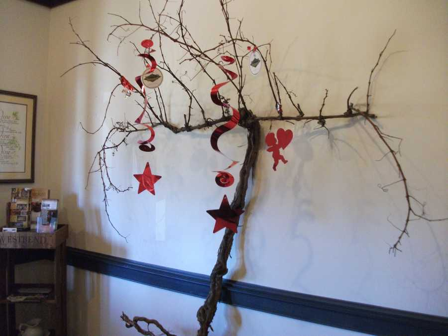 You could have a Valentine's Day Themed Wedding Tree for your table seating name cards attached to branches at the reception. (Westbend Vineyards and Brewhouse)