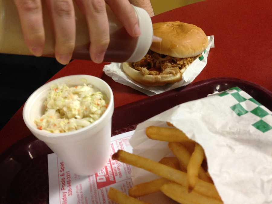 Pig-N-Out  BBQ is known for its Lexington Style Barbecue - slow cooked, moderately chopped, tender, moist, and well sauced out of the kitchen. The taste is slightly sweet, vinegary, with very little smokiness in this pig.