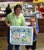 The restaurant features colorful, cheerful local childrens' art on the walls.