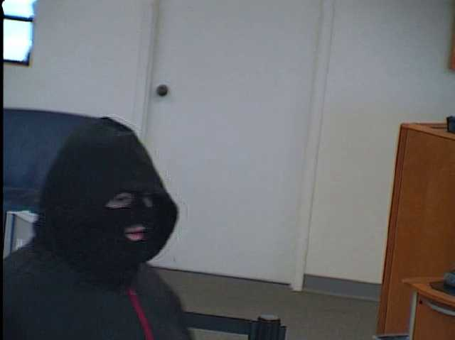 A man is wanted on suspicion of robbing a bank Friday morning in Walkertown. See more surveillance images.
