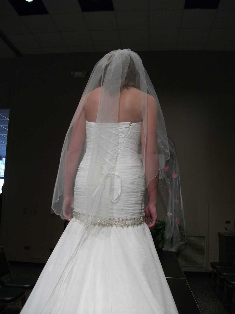 This beautiful back and long veil go well together.