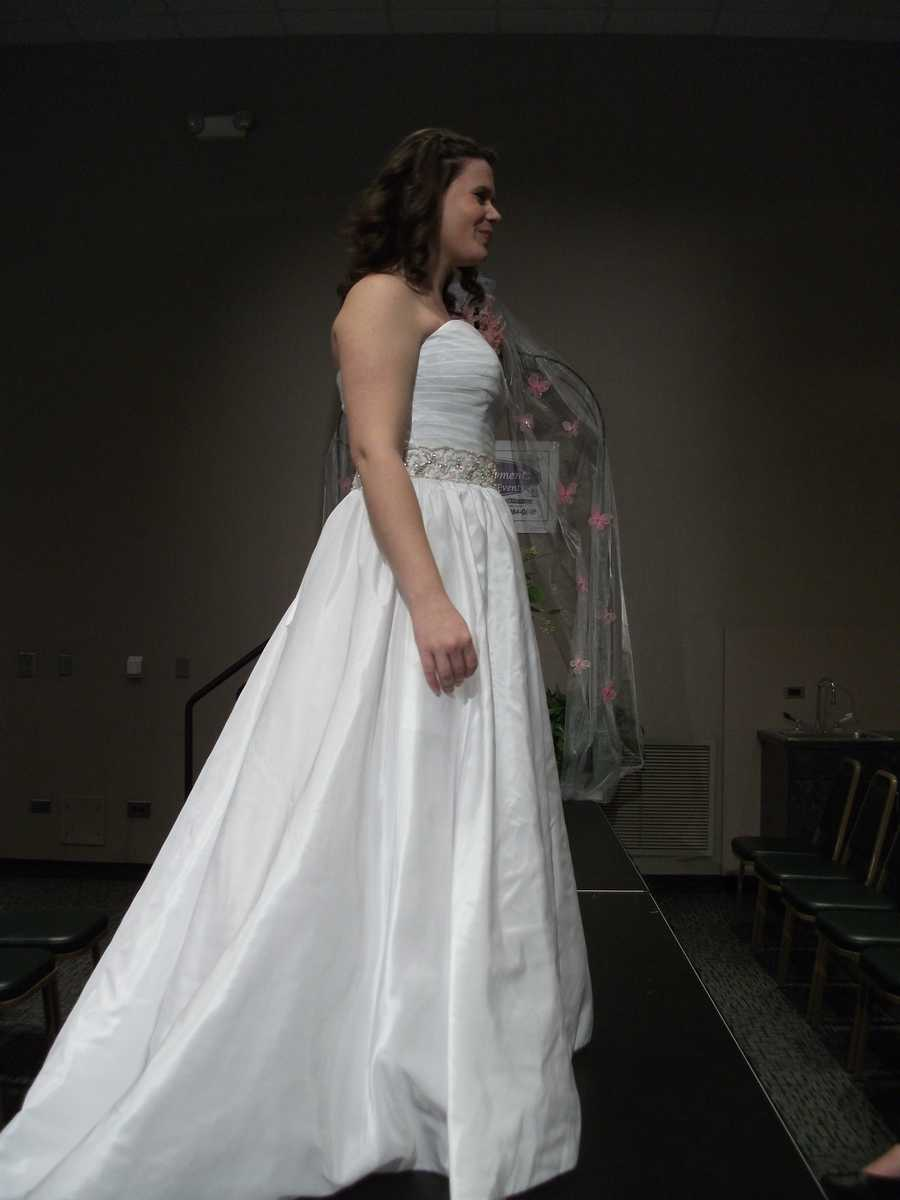 The sequin around the waist line makes the dress stand out from other designs like this one.