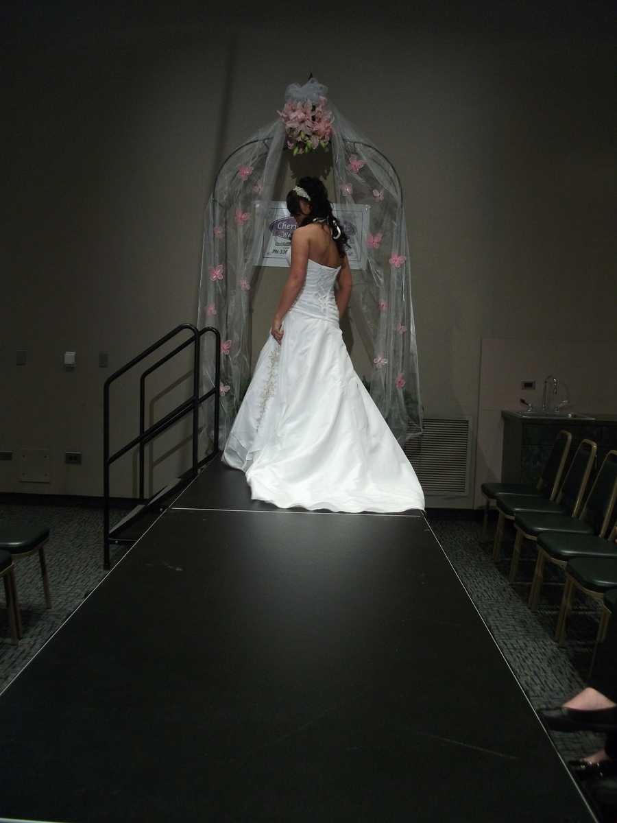 The design on the side of the dress makes this gown unique.