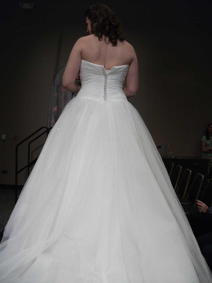The strapless back and long flowing bottom make this a beautiful princess gown for your special day.