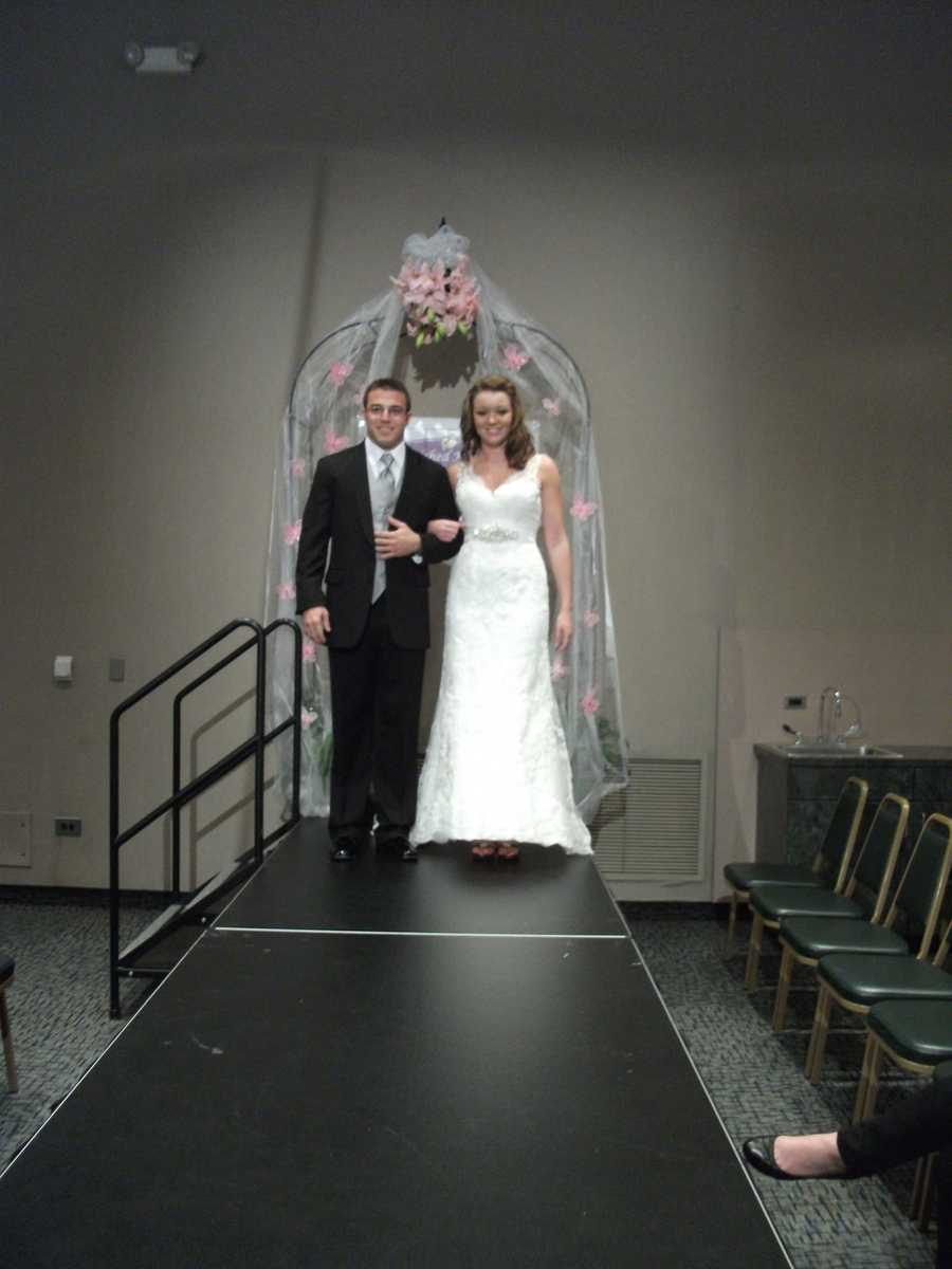 This silver tie and vest with the black suit goes better on the groom to go with the bridal gown.