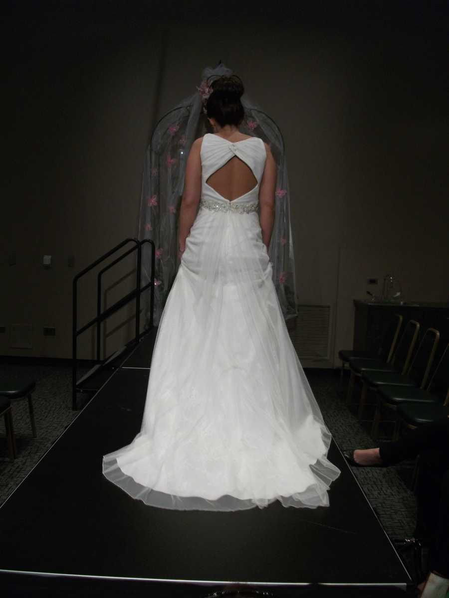 The back of the bridal gown is so interesting and different along with the gathers flowing down the train.