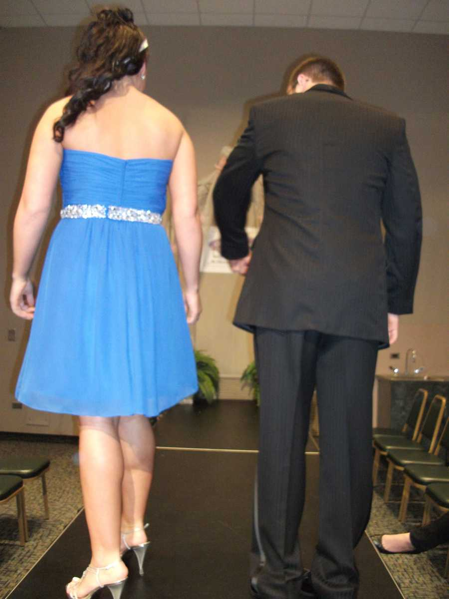 The strapless back and the silver sash wrapping around the waistline makes the dress.