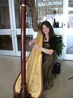 Jo Hanna Johnson was playing the Wedding March on the Harpist at the event. She also plays the piano and sings. Watch and listen to her here. For more information: ncharpist12@ yahoo.com and https://sites.google.com/site/hannaha...