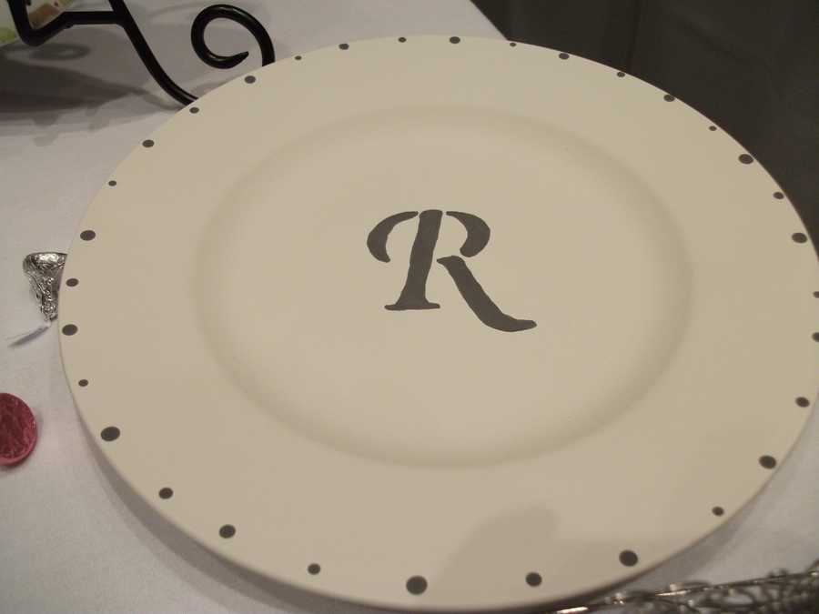 The Potter's Mark could help you make something special like this plate or a whole place setting for the couple.