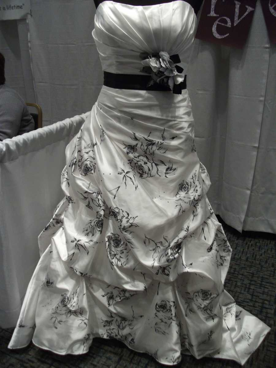 """Bridal Traditions Wedding and Prom Attire had this beautiful wedding dress at their booth. It is very different because of the flower print. This would make a nice """"Romantic Themed Wedding."""""""