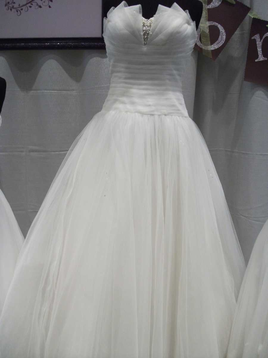 Bridal Traditions Wedding and Prom Attire showed off this nice different styled top and flowing material to make any bride a princess on their special day!