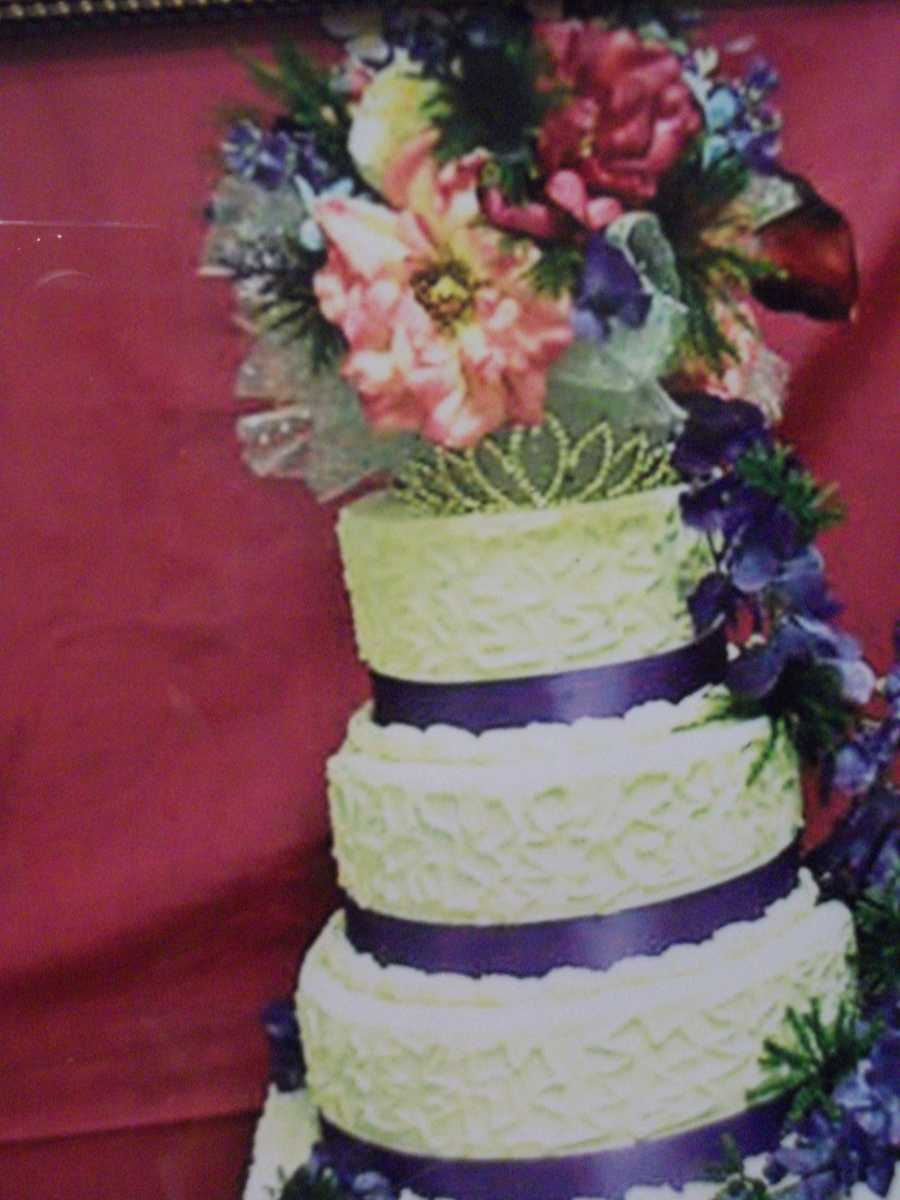 So flowerful topping with cascading flowers on the side of this cake make it a great summer themed wedding cake. (The Cake Lady)