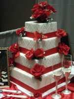 The Cake Lady had this beautiful red and white cake that makes a Valentines/Romantic Themed Wedding.